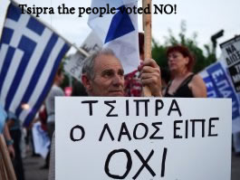 In Greek Phot of man holding sign saying :Tsipras, the people said NO""